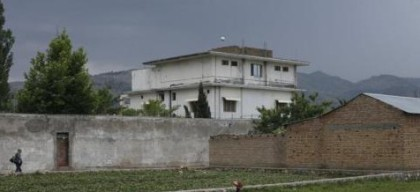 Resident boy Adeel, 8, plays in front of the compound where U.S. Navy SEAL commandos reportedly killed al Qaeda leader Osama bin Laden in Abbottabad