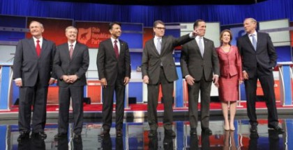 Republican presidential candidates (L-R), former Virginia Governor Jim Gilmore, U.S. Senator Lindsey Graham, Louisiana Governor Bobby Jindal, former Texas Governor Rick Perry, former U.S. Senator Rick Santorum, former HP CEO Carly Fiorina and former New York Governor George Pataki, pose before the start of a Fox-sponsored forum for lower polling candidates held before the first official Republican presidential candidates debate of the 2016 U.S. presidential campaign in Cleveland, Ohio, August 6, 2015. (Photo: Aaron Josefczyk/Reuters)