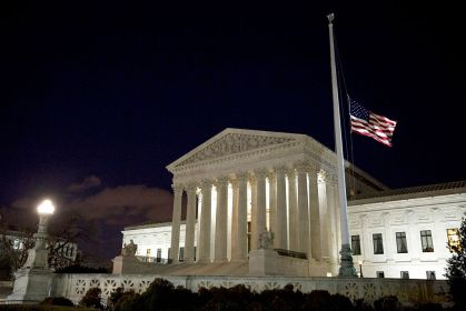 WASHINGTON, DC - FEBRUARY 13: The American flag flies at half mast at the U.S. Supreme Court February 13, 2016 in Washington, DC. Supreme Court Justice Antonin Scalia was at a Texas Ranch Saturday morning when he died at the age of 79. (Photo by Drew Angerer/Getty Images)