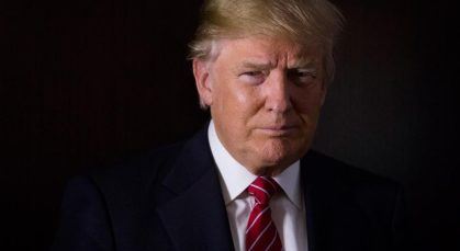 Donald Trump, president and chief executive of Trump Organization Inc. and 2016 Republican presidential candidate, stands for a photograph after a Bloomberg Television interview at his campaign headquarters in Trump Tower in New York, U.S., on Thursday, Oct. 15, 2015. According to Trump, Janet Yellen's decision to delay hiking interest rates is motivated by politics. Photographer: John Taggart/Bloomberg via Getty Images *** Local Capton *** Donald Trump